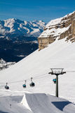 People skiing in snowpark. Cabine lift line at Madonna di Campiglio ski area, Grost Royalty Free Stock Photos