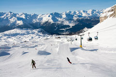 People skiing in snowpark. Snowpark at Madonna di Campiglio ski area, near Grostè. Madonna di Campiglio is one of the most famous area in Italian Alps, in the Royalty Free Stock Images