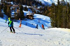 People skiing in Switzerland, Swiss Alps royalty free stock images