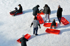 People with sleds in Whakapapa skifield on Mount Ruapehu Royalty Free Stock Photos