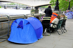 People sleep in a tent. LONDON - JUNE 01: Unidentified people sleep in a tent alongside the River Thames to witness Thames Diamond Jubilee boats parade on June 1 Royalty Free Stock Photos