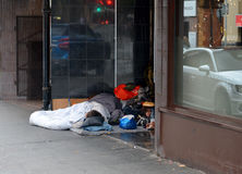People sleeping in a doorway Royalty Free Stock Photography