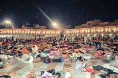 People sleeping on the floor of of the Sikh Golden Temple in Amritsar, India stock images