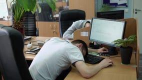 People sleeping in office stock video