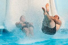 People sliding at water park Royalty Free Stock Photography