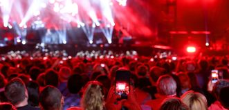 People with smart phone at live concert. Many people with smart phone at live concert stock image