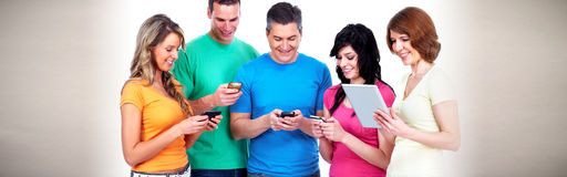 People with smartphones stock photo
