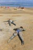 People smeared healing mud. KRK, CROATIA - SEPTEMBER 12, 2011: People smeared with healing mud on beach on September 12, 2011 in Krk, Croatia. Healing mud stock photography