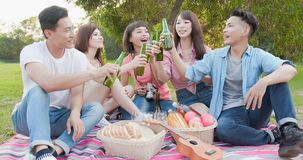 People enjoy beer. People smile happy enjoy beer and go on a picnic stock photography