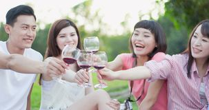 People enjoy red wine. People smile happy enjoy red wine and go on a picnic stock image