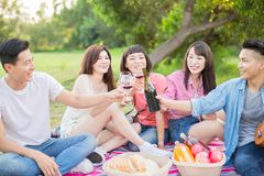 People enjoy red wine. People smile happy enjoy red wine and go on a picnic royalty free stock image