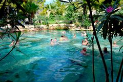 People smin in the antique Cleopatra`s pool with thermal water under sunlight royalty free stock image