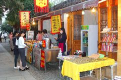 Women buy snack food in Shantang Old Street in water town Suzhou, China Stock Image