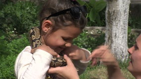 People with snake in the village of Anton in Bulgaria. Mountain village Anton - Bulgarian center of rural tourism, national rural architecture and a popular stock video footage