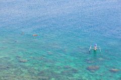 People snorkeling in turquoise water on Bali Stock Image