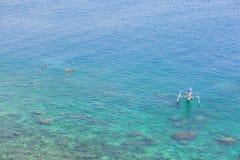 People snorkeling in turquoise water on Bali. People snorkeling in turquoise water on the Eastern coast of Bali Stock Image