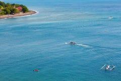 People snorkeling in turquoise water on Bali. People snorkeling in turquoise water on the Eastern coast of Bali Stock Photo