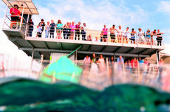 People snorkelling and dive from a platform in the Great Barrier Reef in Queensland, Australia. Stock Photos