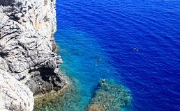 People snorkiling at a Secret cove Rhodes Greece Royalty Free Stock Photography