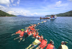 People snorkle in a bay of tarutao Stock Photography