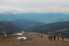 People in snow mountains Royalty Free Stock Image