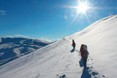 People in snow mountains Stock Image