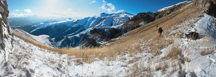 People in snow mountains Royalty Free Stock Images