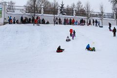 People snow-tubing in the winter park in Dubrovitsy village near Podolsk stock photography