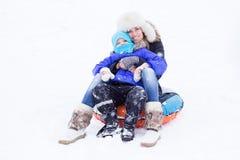People snow tubing Stock Photo