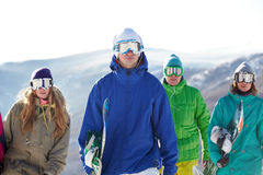 People with snowboards. Four people in ski goggles carrying snowboards Royalty Free Stock Image