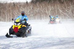 People on snowmobile in winter mountain Royalty Free Stock Photos