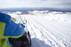 People on snowmobile in winter mountain Royalty Free Stock Photo