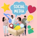 People with social media icons in the box stock photo