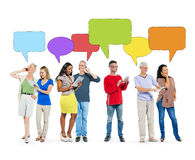 People Social Networking and Empty Speech Bubbles Stock Photo