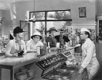 People at a soda fountain Royalty Free Stock Photography