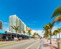 People on South Fort Lauderdale Beach Boulevard on a sunny day. Fort Lauderdale, USA - February 22, 2019: People on South Fort Lauderdale Beach Boulevard on a royalty free stock photos