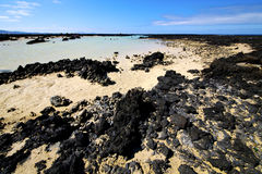 People spain  hill   spiral of black. People spain  hill white  beach  spiral of black rocks in the   lanzarote Stock Image