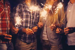 People with sparklers on outdoor party Royalty Free Stock Image