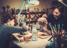 People in a special fx workshop. People working in a prosthetic special fx workshop Royalty Free Stock Images