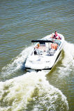 People in speedboat Royalty Free Stock Image
