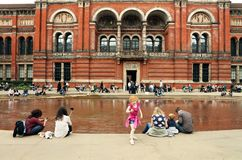 People spending their sunday afternoon in the courtyard at the Victoria and Albert Museum in London. Victoria and Albert Museum, the John Madejski Garden. V&A royalty free stock photography