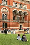 People spending their sunday afternoon in the courtyard at the Victoria and Albert Museum in London. Victoria and Albert Museum, the John Madejski Garden. V&A royalty free stock photo
