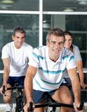 People On Spinning Bike In Health Club Royalty Free Stock Image