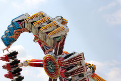 People on Spinning Carnival Ride. Brave young people are riding a spinning amusement park ride at an American Carnival Royalty Free Stock Photo