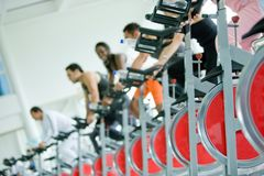 People spinning at the gym Stock Photo