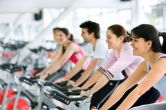 People spinning at the gym Royalty Free Stock Photo