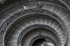 People on spiral staircase