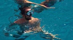 People splash and swim Stock Photos