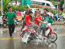 People splashing water on the street at Songkran festival in Thailand. Traditional thai celebration royalty free stock image