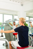 People in sport gym on the fitness machine Royalty Free Stock Photos